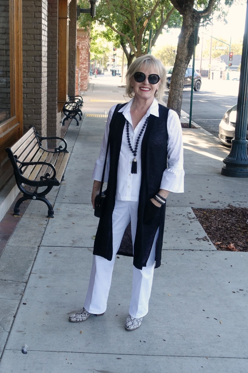 casual look with column of white with black long vest on Jennifer Connolly of A Well Styled Life