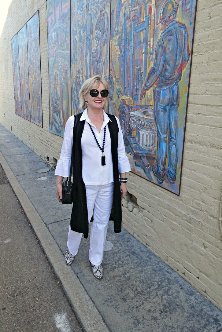 Jennifer Connolly wearing column of white with black linen vest