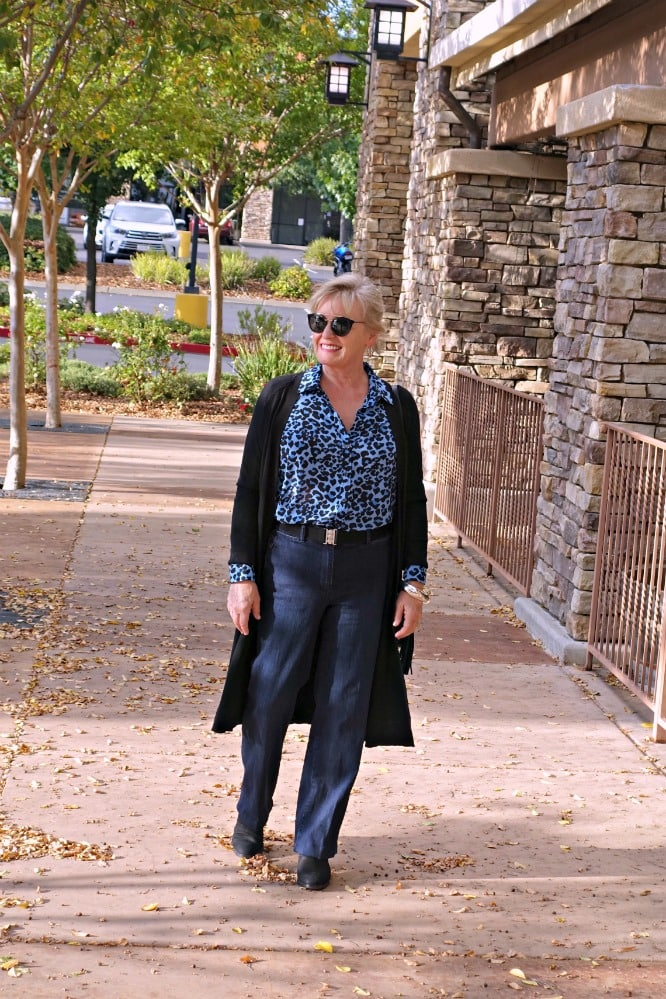 Jennifer Connolly of A Well Styled Life wearing casual look with leopard top and blue jeans