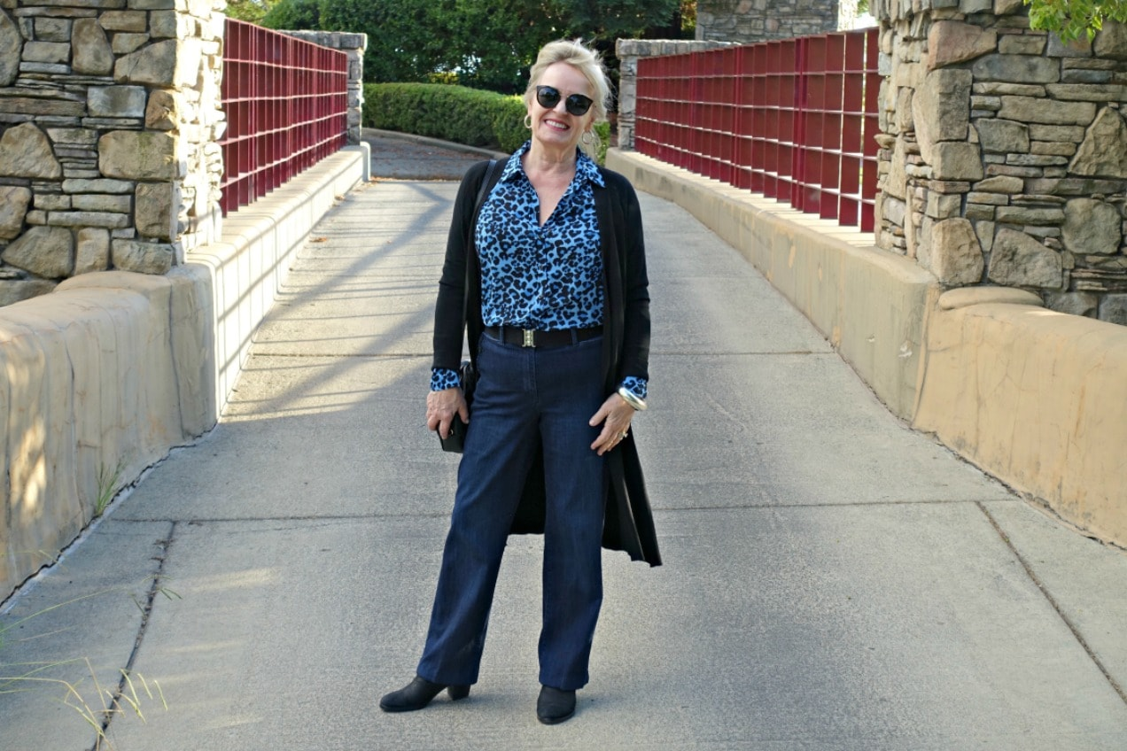 Jennifer Connolly of A Well Styled Life wearing Talbots denim trousers with blue leopard shirt