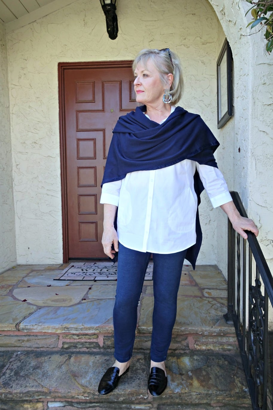 Jennifer Connolly of A Well Styled Life wearing navy ruana and white shirt