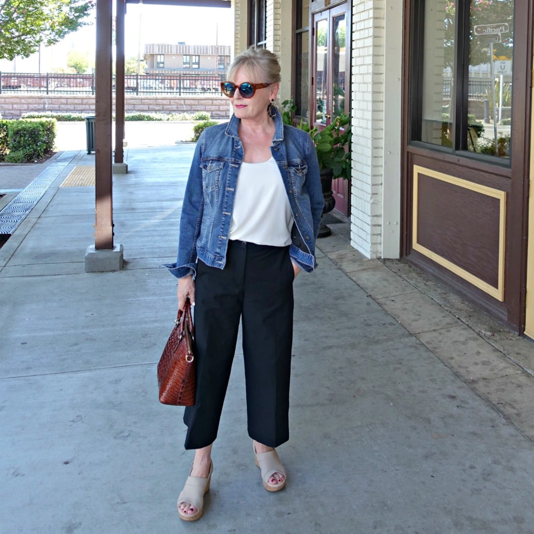 casual outfit of denim jacket and black crops on Jennifer Connolly of A Well Styled Life