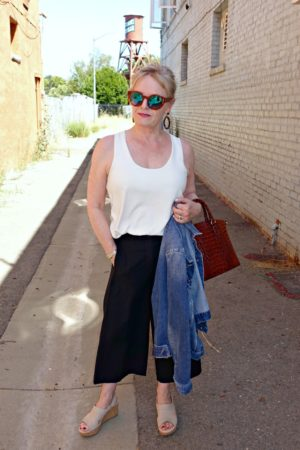Jennifer Connolly of A Well Styled Life wearing casual outfit with denin jacket and wide crop pants from Ann Taylor