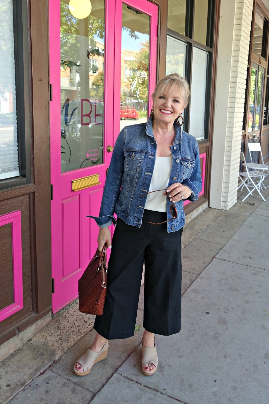 Jennifer Connolly of A Well Styled Life wearing casual fall look with denim jacket and wide cropped pants