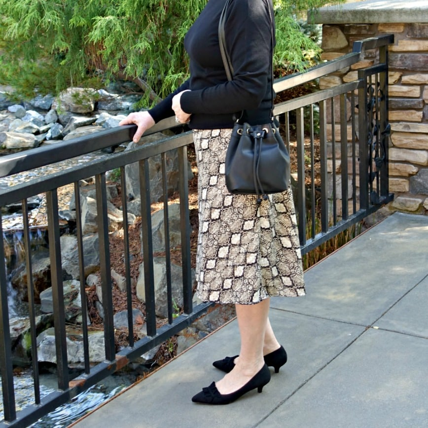 Jennifer Connolly of A Well Styled Life wearing kitten heels with midi skirt