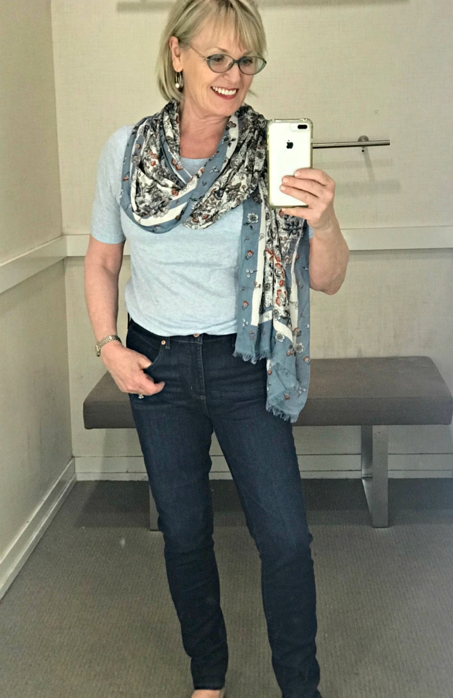 causal outfit of blue tee, jeans and floral scarf on Jennifer Connolly of A Well Styled Life