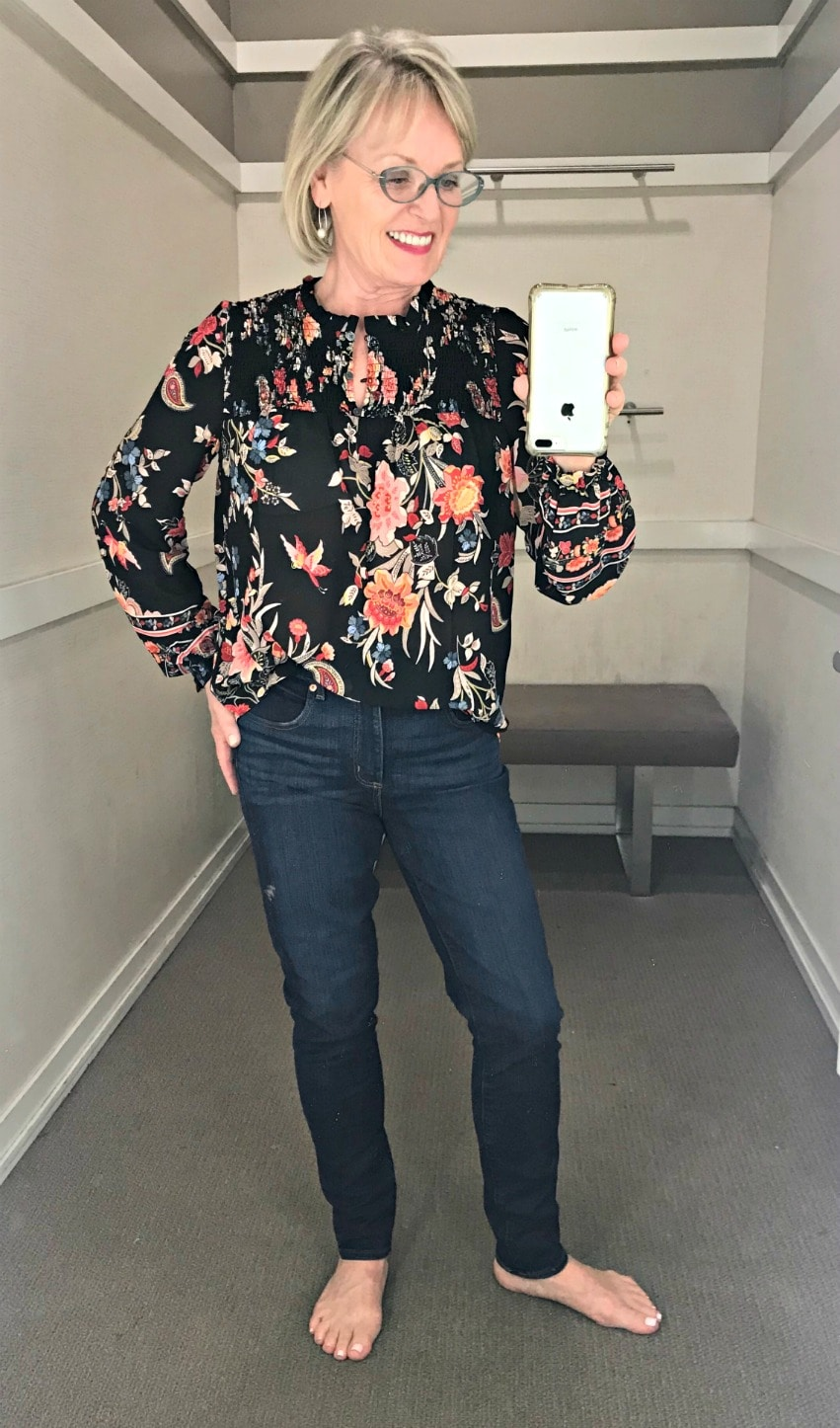 Jennifer Connolly of A Well Styled Life wearing dark floral top in the Loft changing room