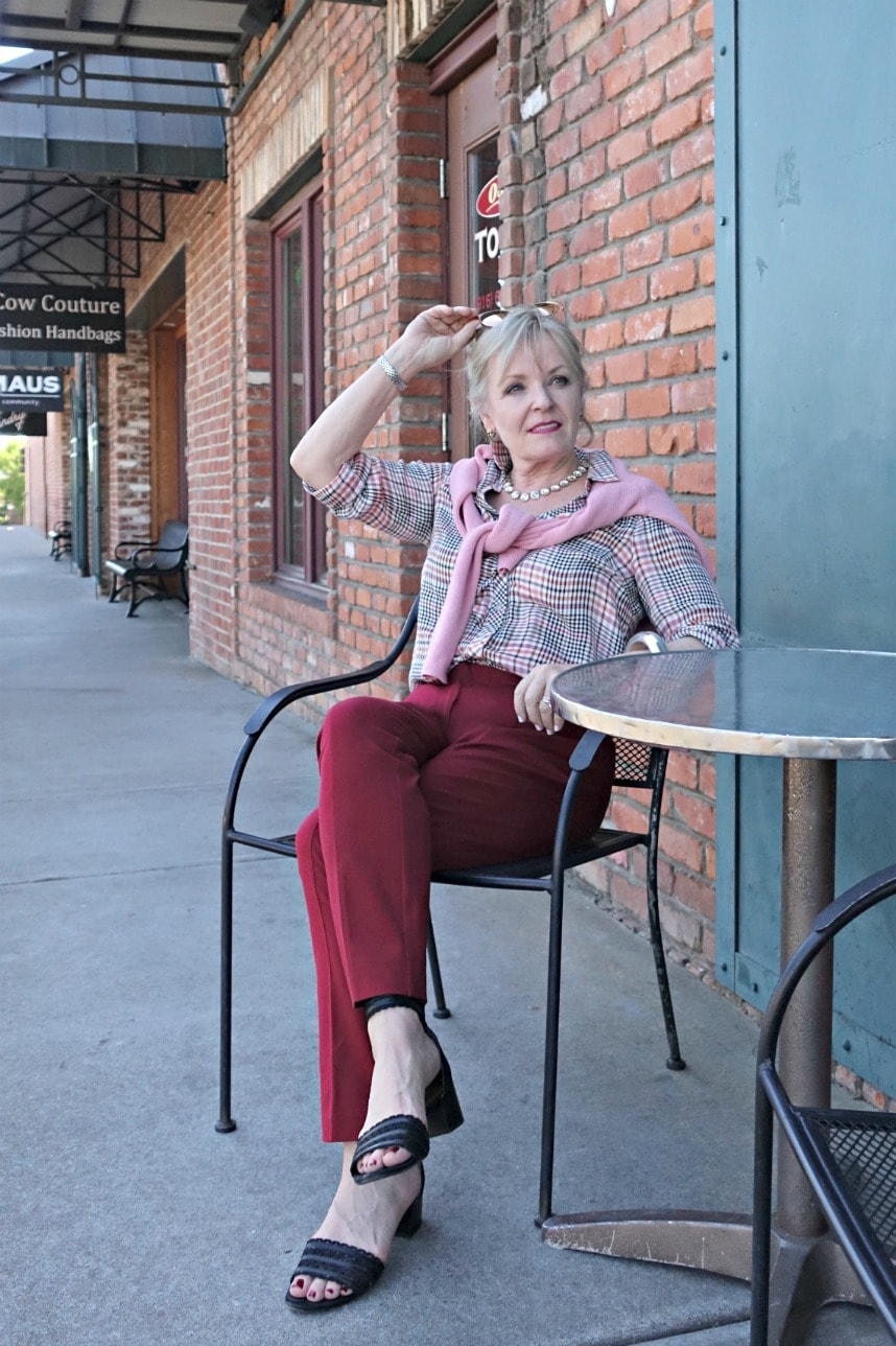 casual outfit on Jennifer Connolly of A Well Styled Life with pink sweater and red pants