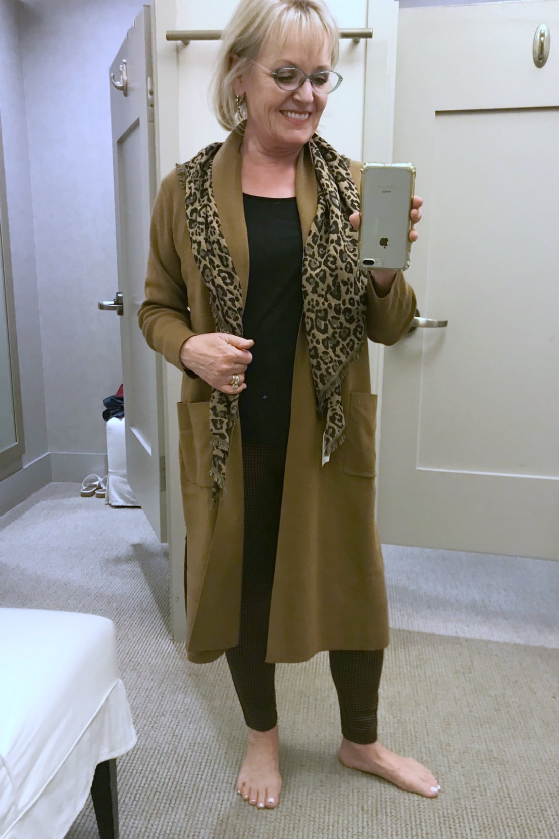 Jennifer Connolly of A Well Styled life wearing j.jill sweater and scarf in changing room at j.jill