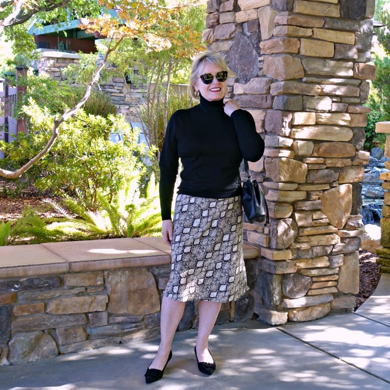 Jennifer Connolly wearing midi skirt and turtleneck sweater