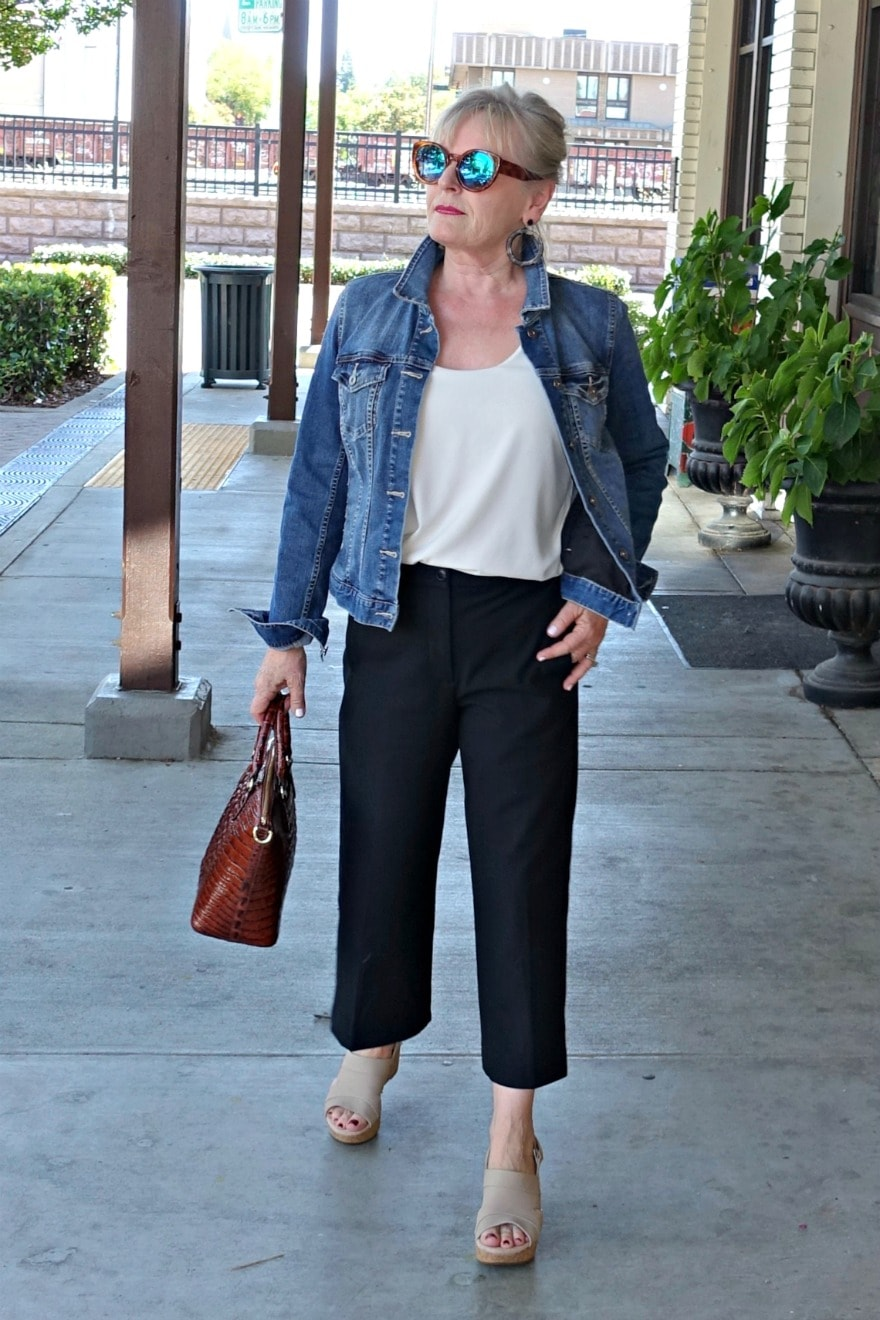 Jennifer Connolly of A Well Styled Life wearing wide cropped pants and denim jacket