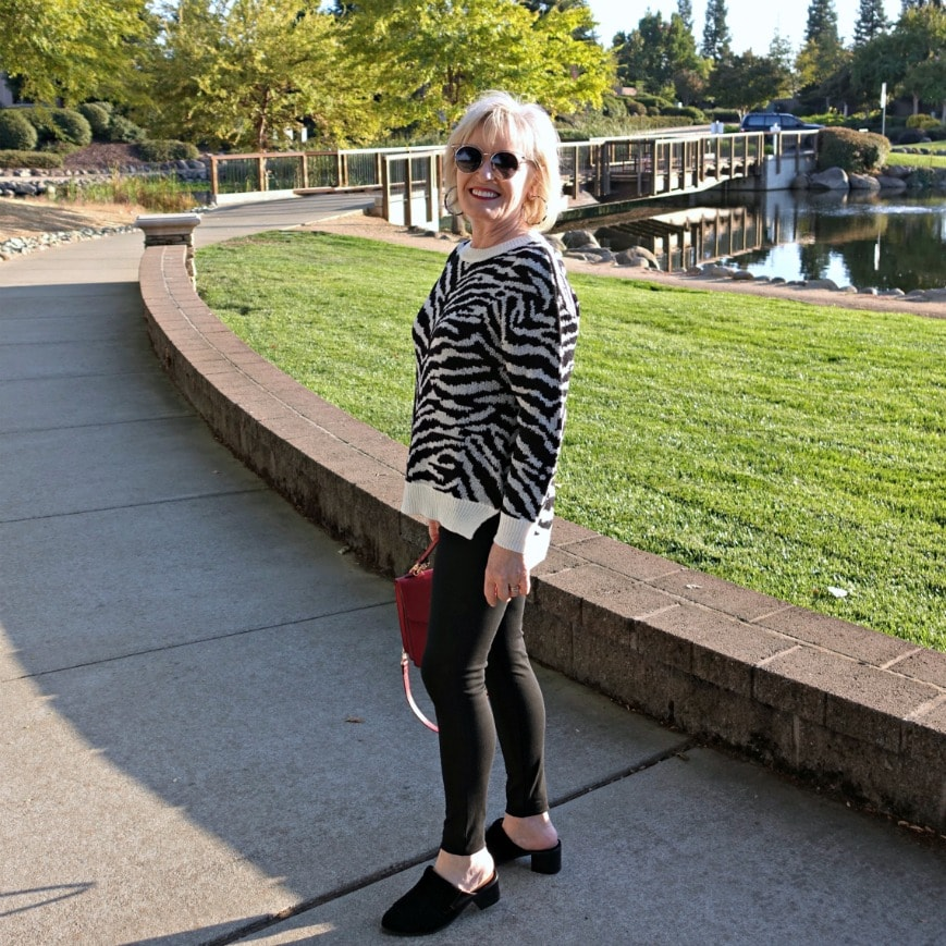 leopard sweater with black jeggings and red crossbody from Walmart on A Well Styled Life