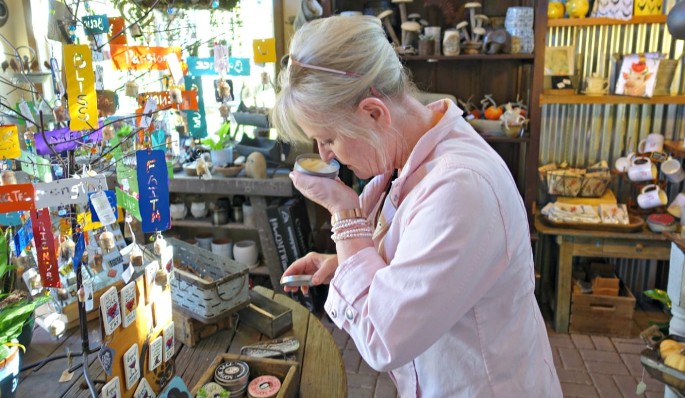 Sniffing hand salve at country shop