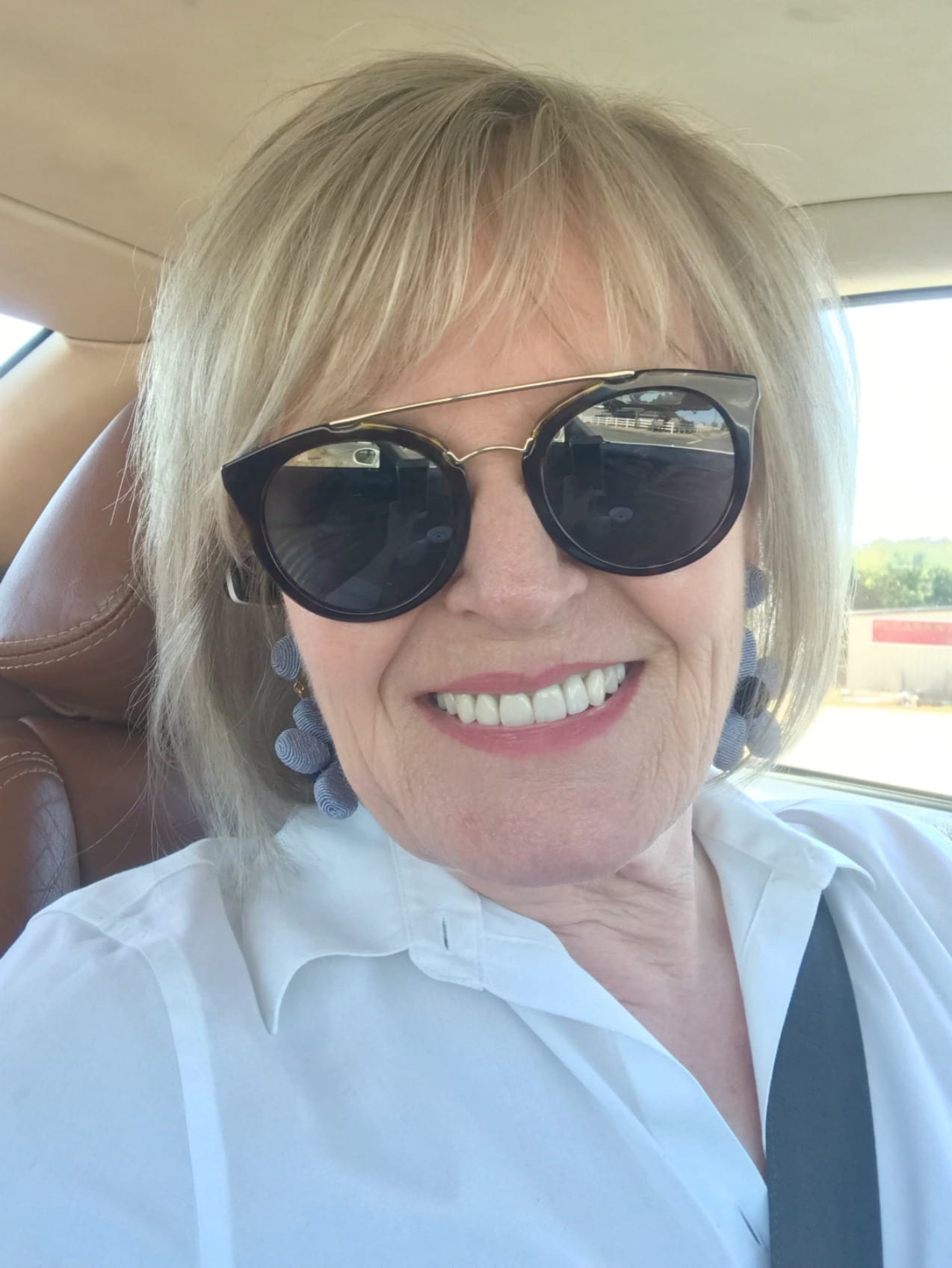 Jennifer Connolly of A Well Styled Life wearing white shirt and sunglasses