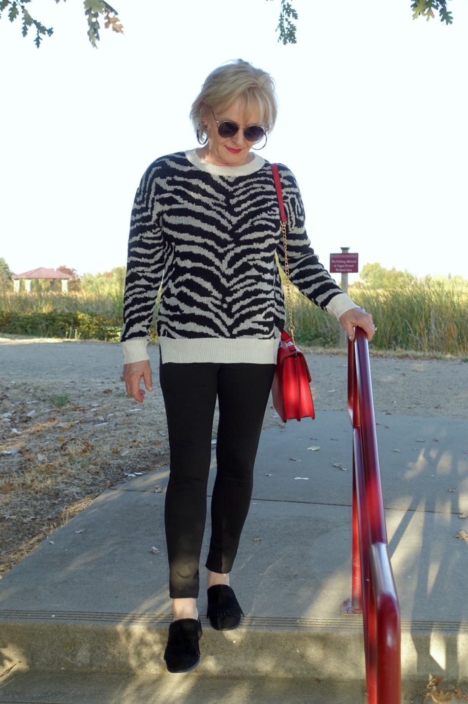 Jennifer Connolly of A Well Styled Life wearing zebra sweater with black leggings