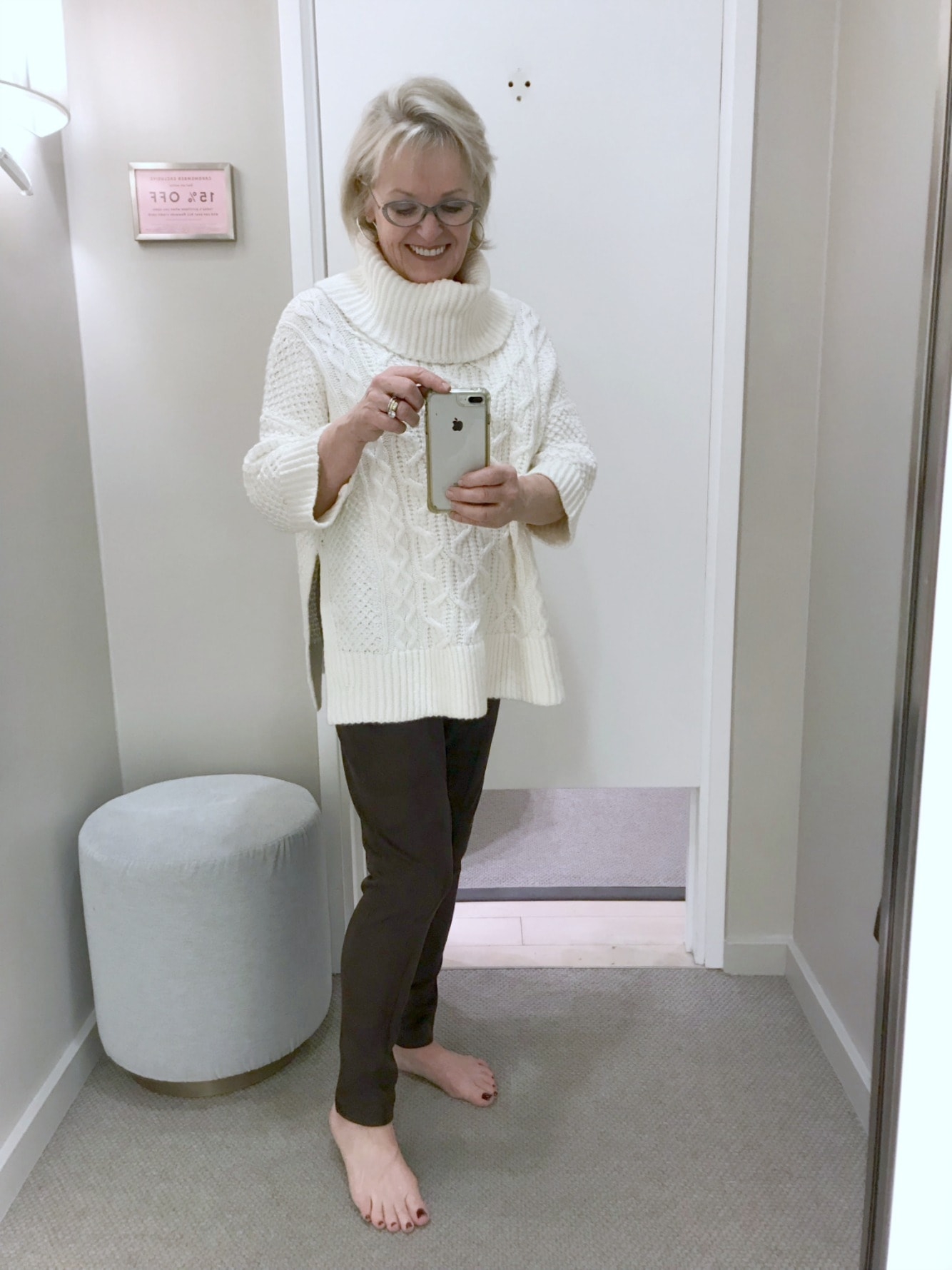 Jenifer Connolly wearing faux suede leggings and cabled poncho from Ann Taylor