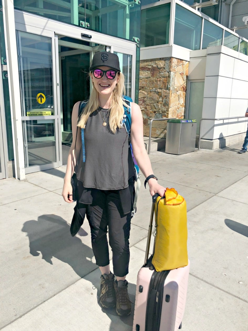 woman at airport with carry on for trip to Africa