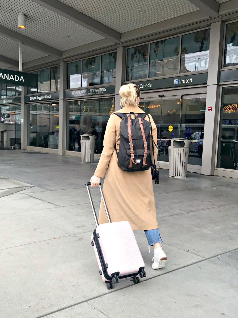 entering airport with backpack and travel spinner from Nordstrom