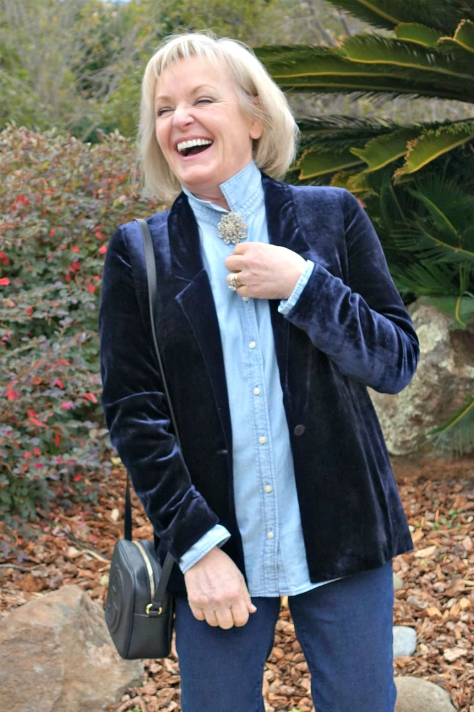 Jennifer Connolly of A Well Styled Life wearing blue velvet blazer over chambray and denim