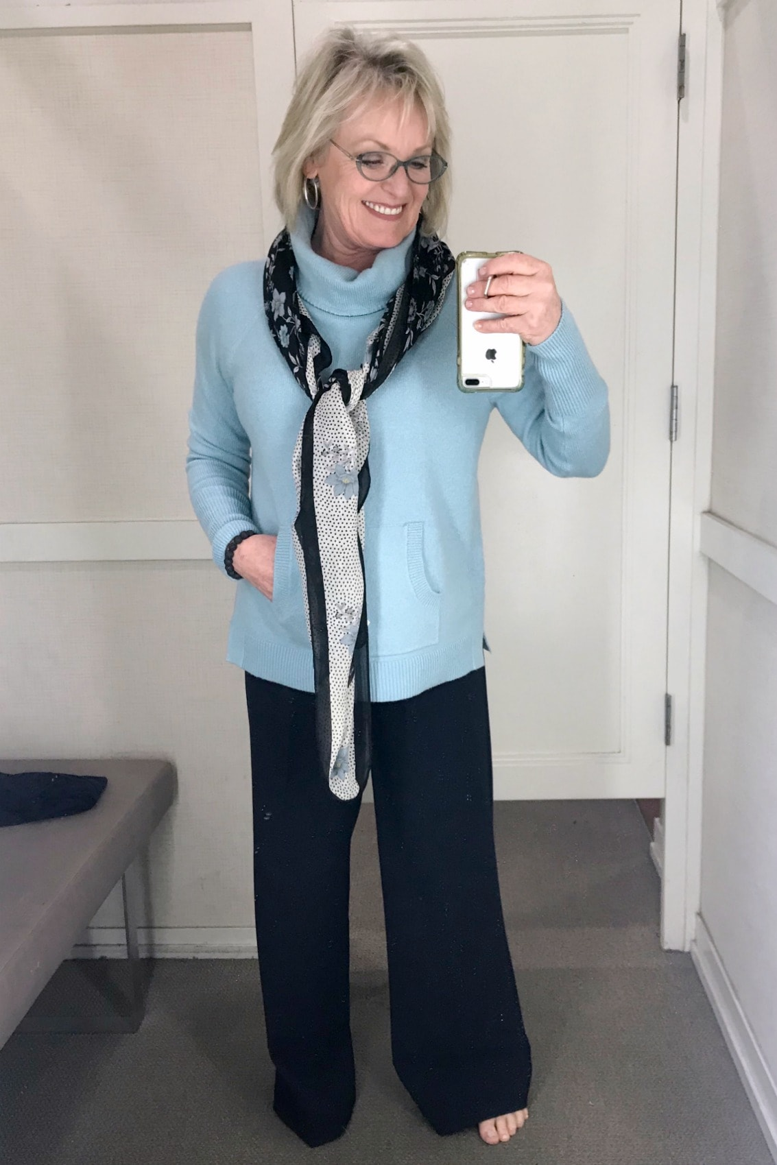 Jennifer Connolly of A Well Styled Life wearing wide leg trousers and blue turtleneck from Loft