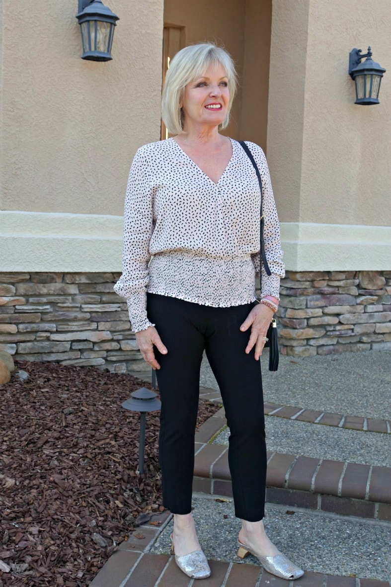 Jennifer Connolly of A Well Styled Life wearing pink wrap blouse and black cigarette pants
