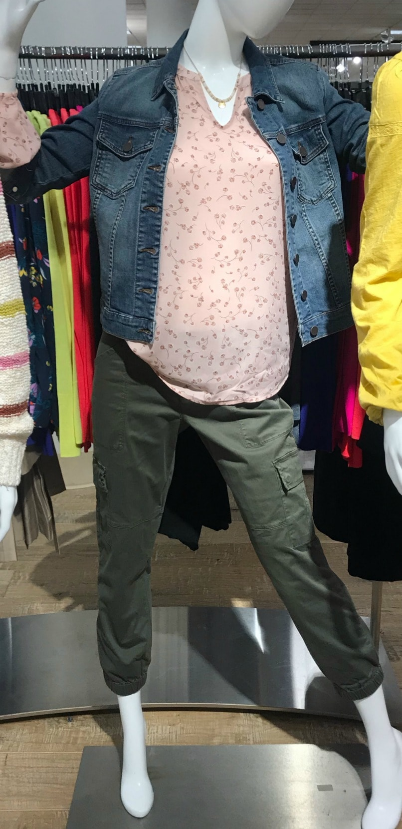 mannequin wearing denim jacket and cargo pants