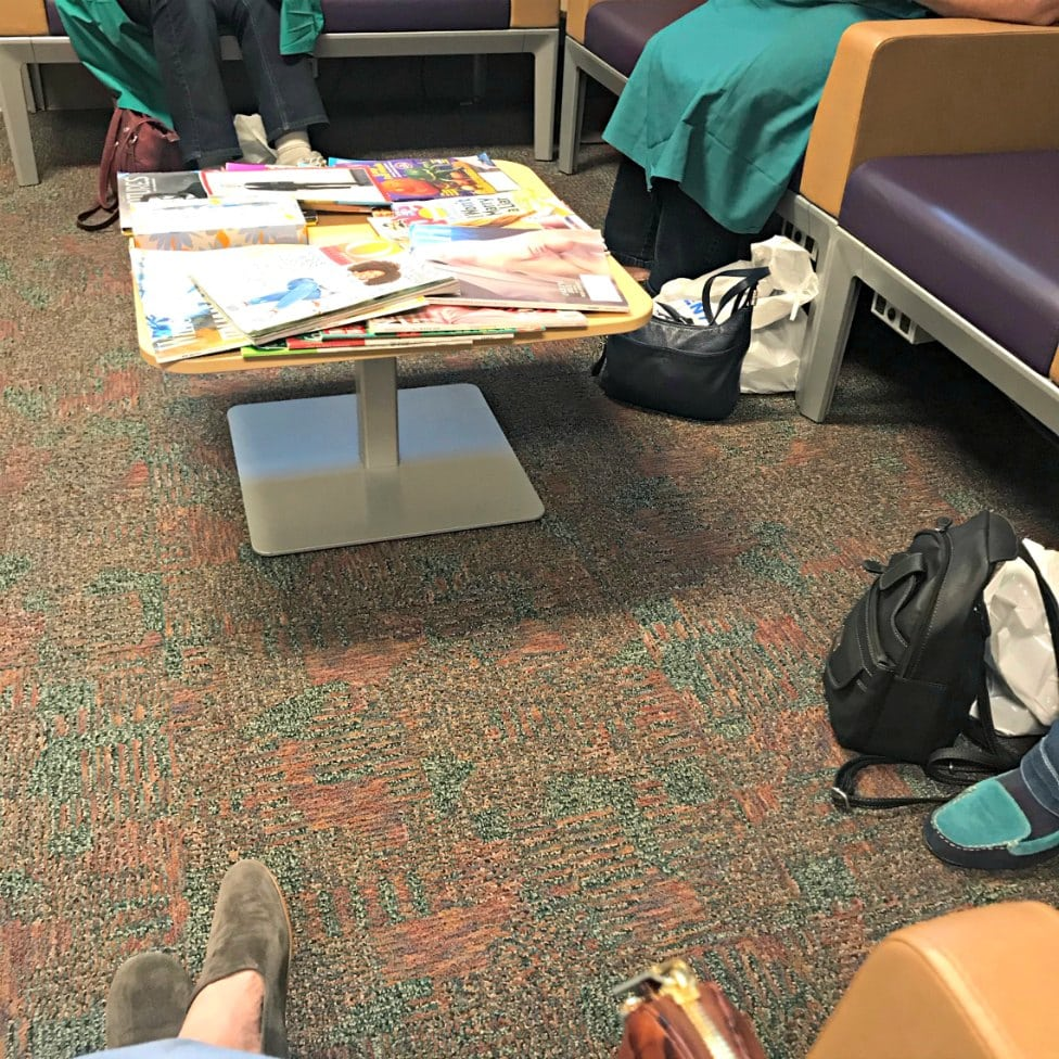 ladies handbags on floor in hospital waiting room