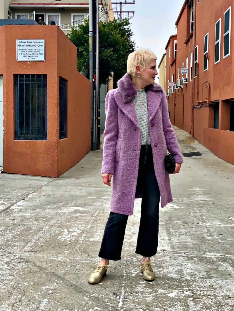 blone woman in purple coat and black pants