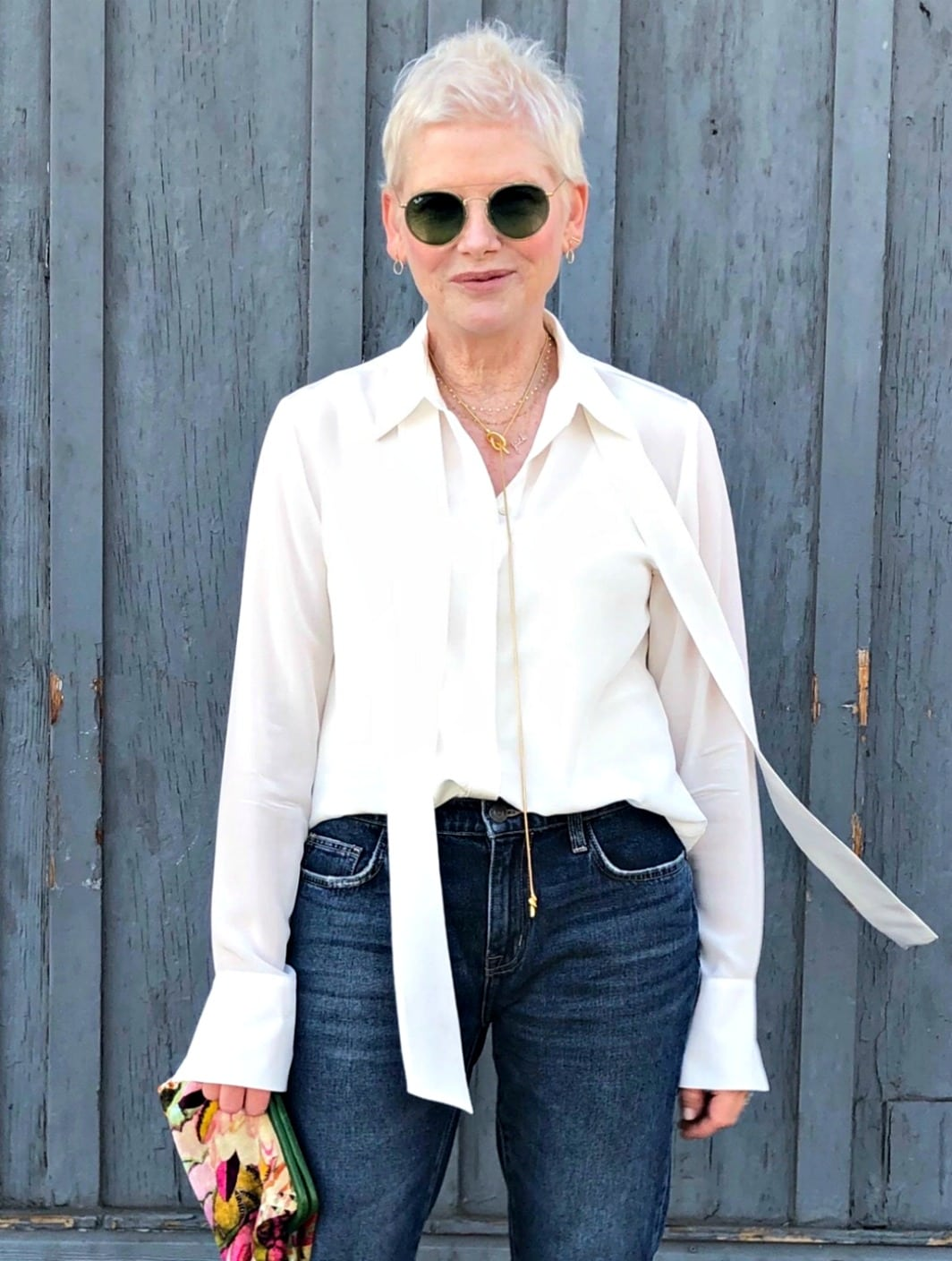woman in white shirt and blue jeans