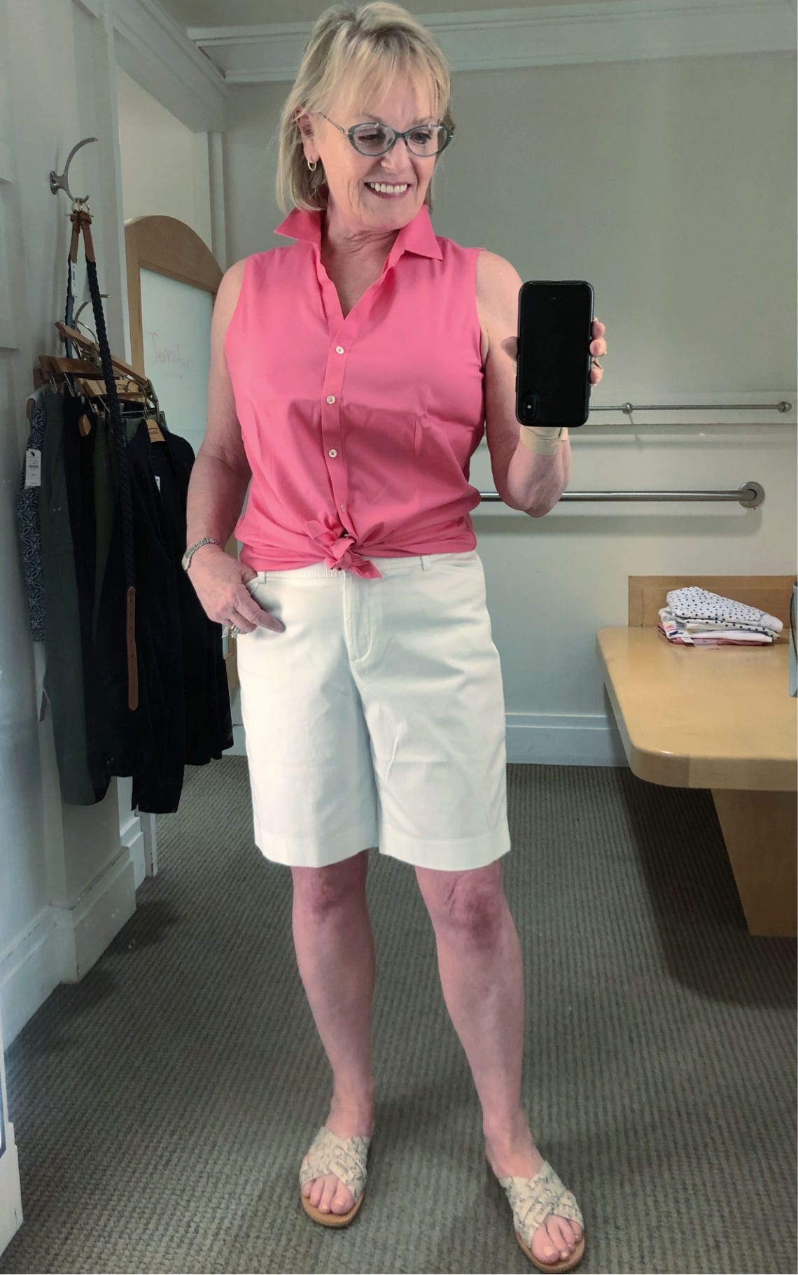 Jennifer Connolly of A Well Styled Life wearing casual chic outfit with bermuda shorts and geranium colored shirt