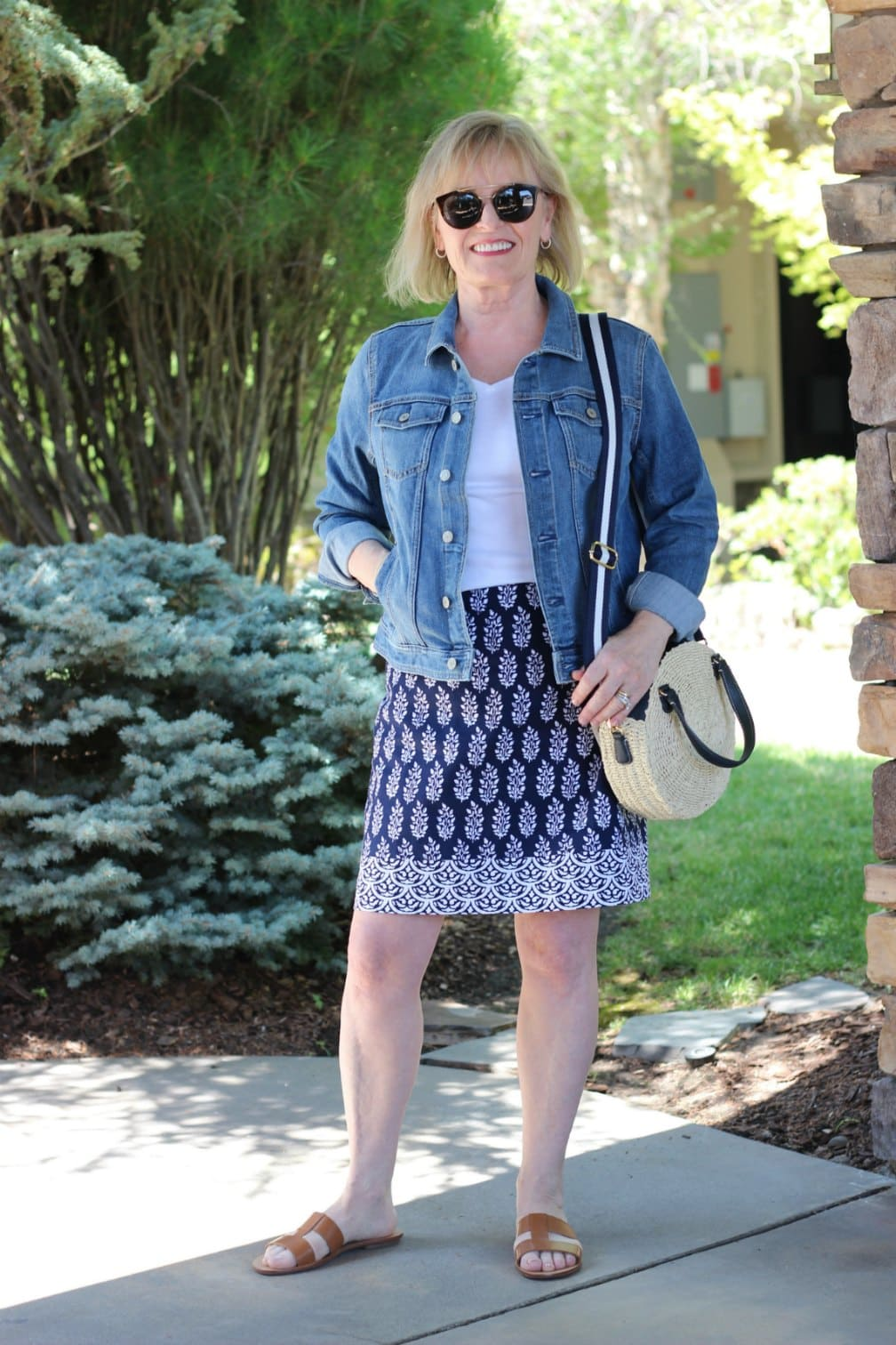 over 50 blogger wearing Talbots denim jacket and geo print skirt