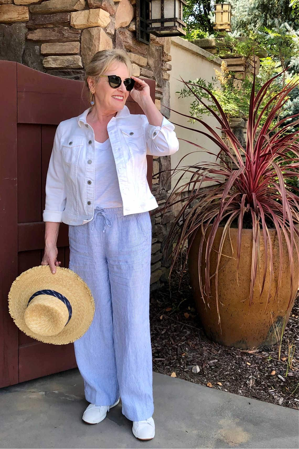 Jennifer Connolly wearing Chico's linen pants and white denim jacket