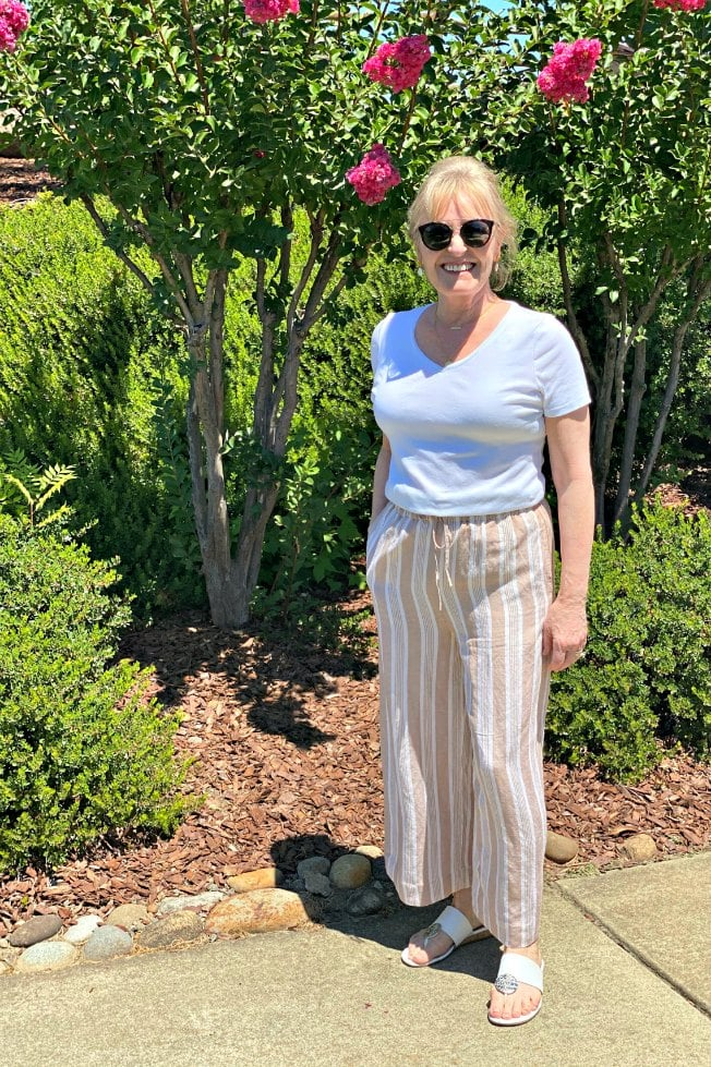 petite over 50 blogger wearing stripe crop pants and white tee