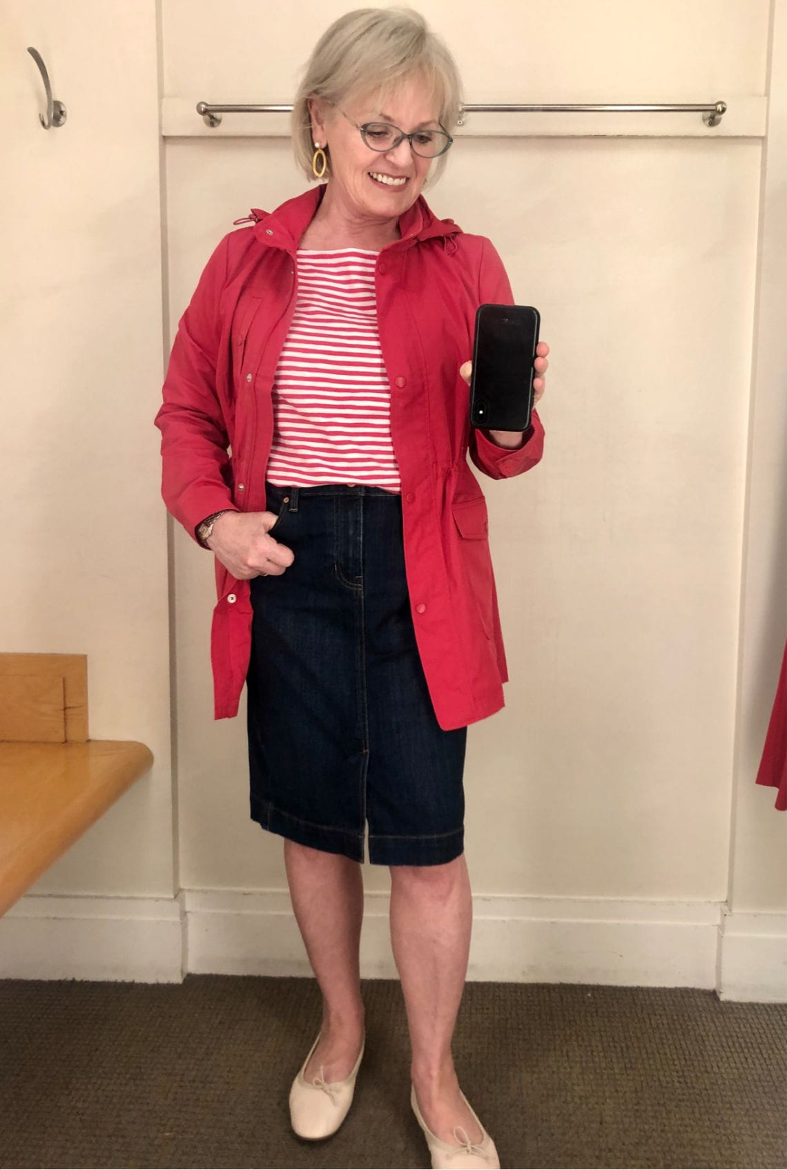 fashion blogger Jennifer Connolly trying on Talbots red rain jacket