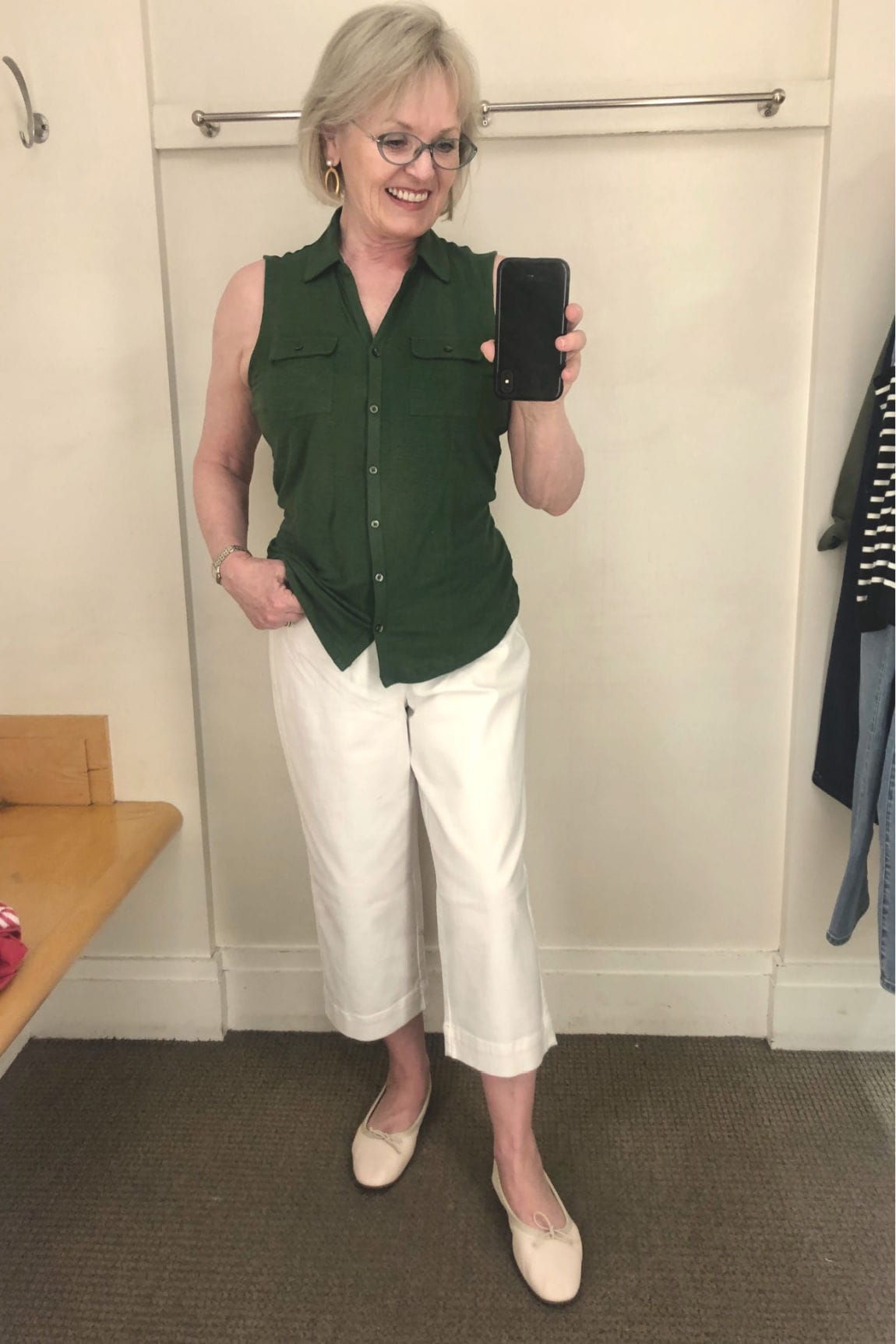 fashion blogger Jennifer Connolly trying on green top and white pants at Talbots