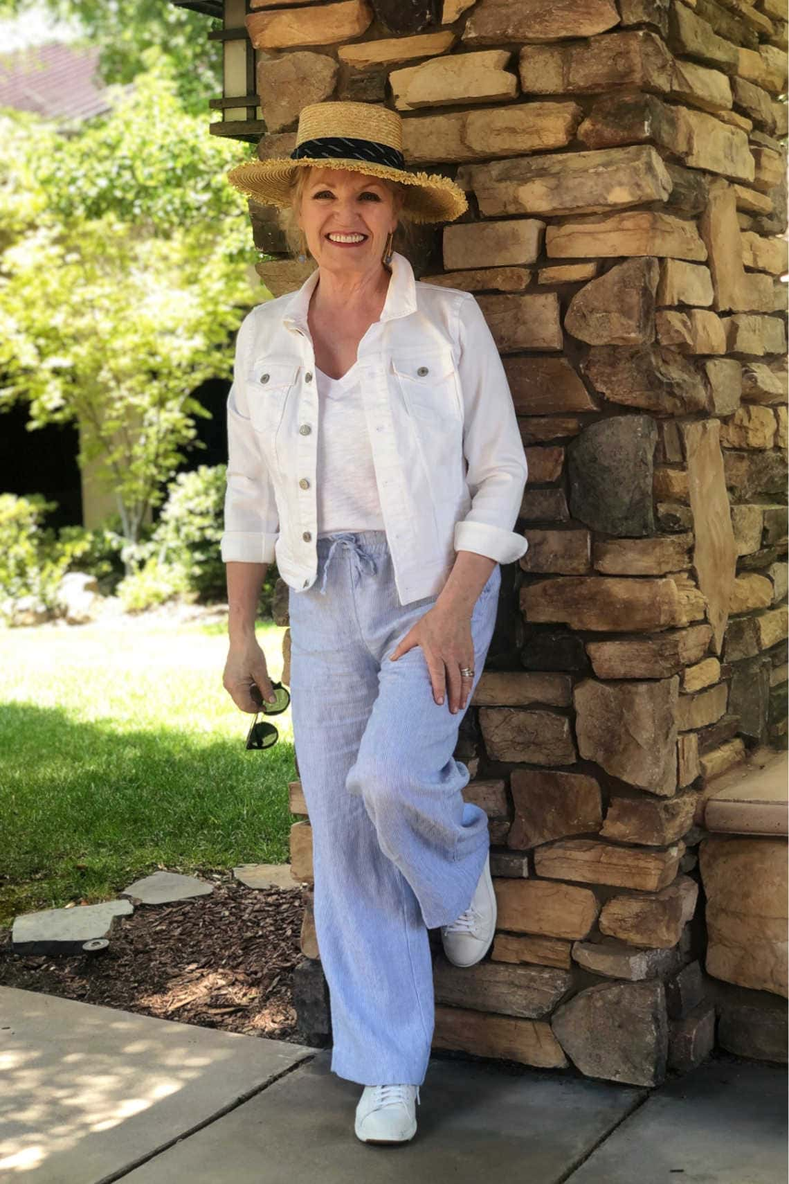 Jennifer Connolly wearing blue linen pants and white denim jacket