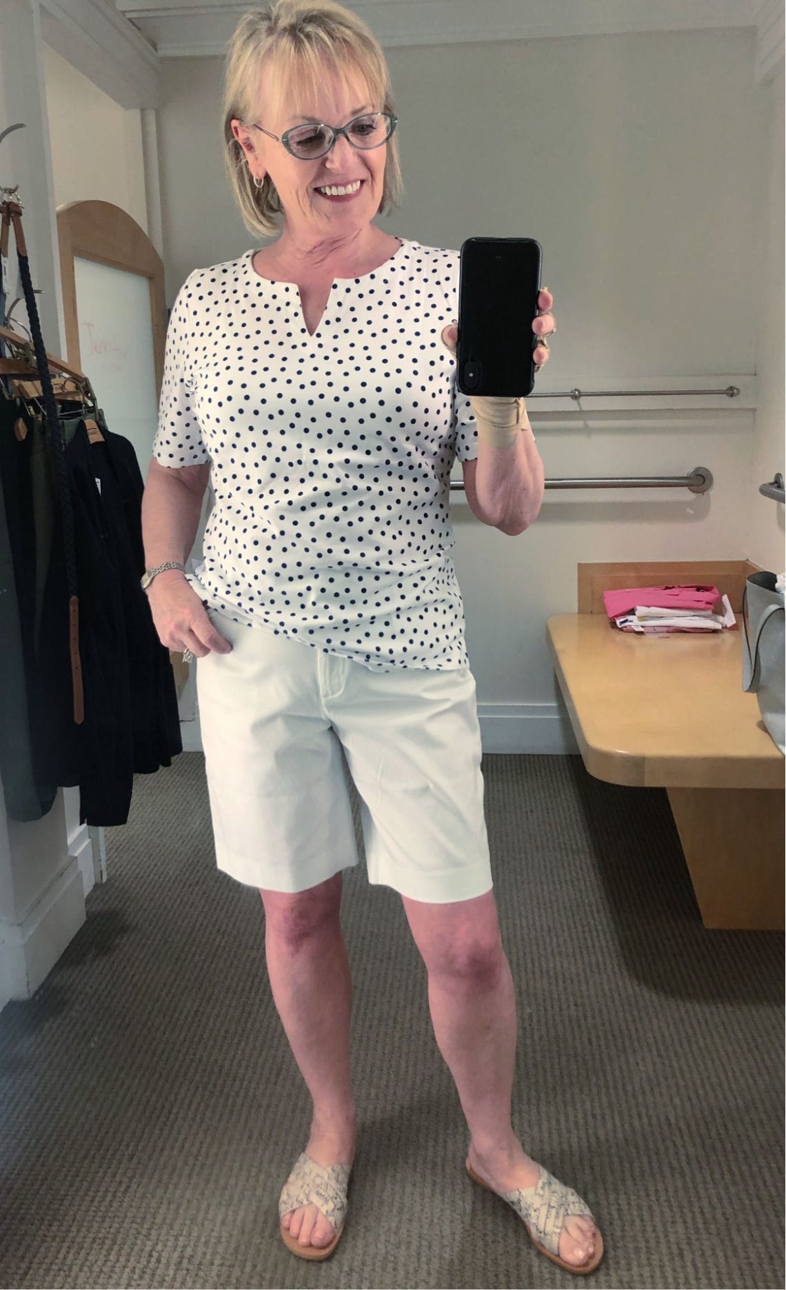 Over 50 blogger Jennifer Connolly wearign split neck tee and white shorts from Talbots