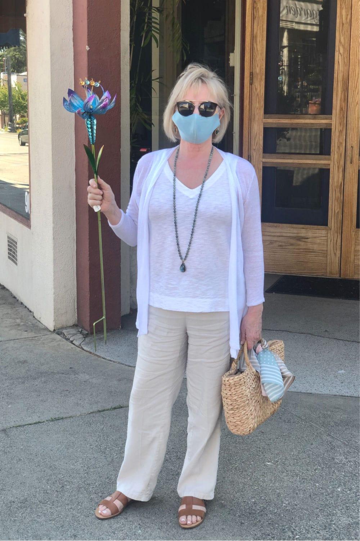 fashion blogger Jennifer Connolly wearing aqua silk face mask