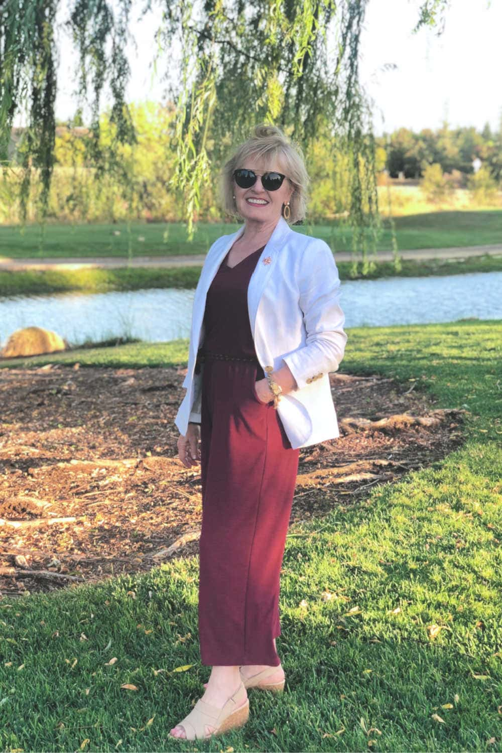fashion blogger jennifer connolly showing wearing Talbots blazer over athleisure jumpsuit