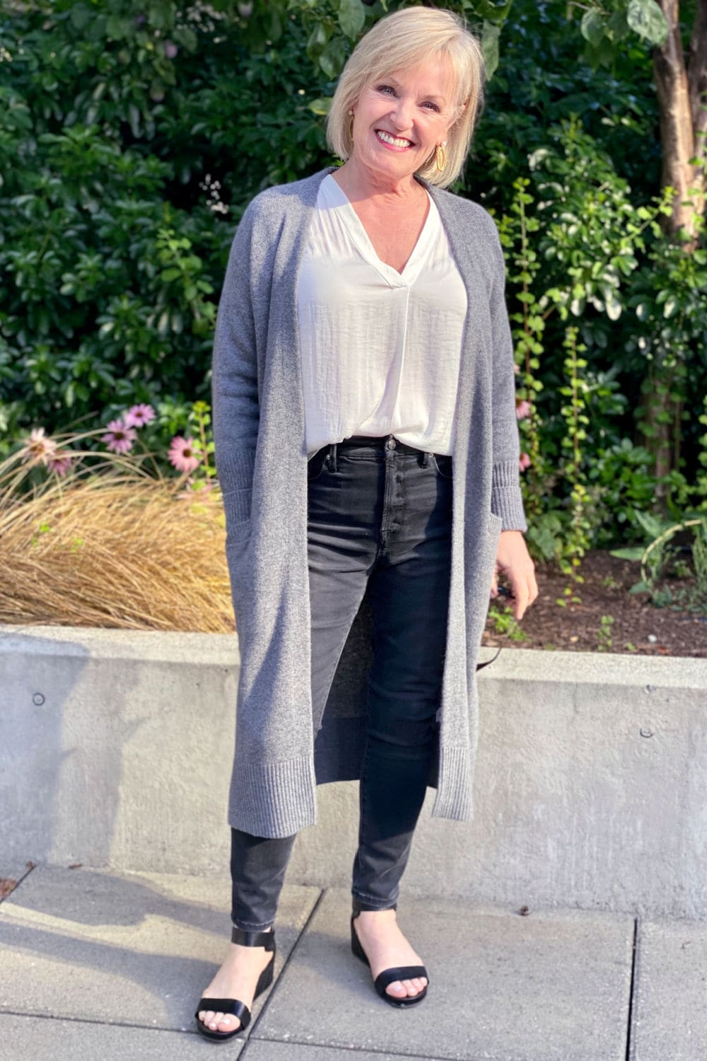 jennifer Connolly wearing a casual outfit from the 2020 nsale of long gray sweater over good american jeans