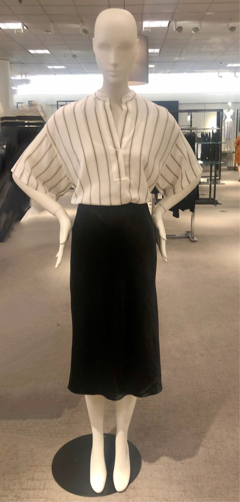 MANNEQUIN WEARING STRIPED TOP AND BLACK TULIP SKIRT