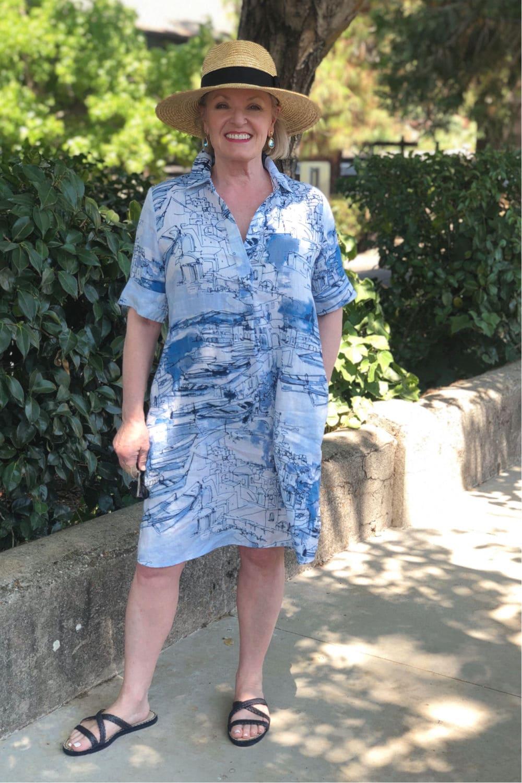 fashion blogger Jennifer Connolly wearing blue dress and Dean Davidson earrings