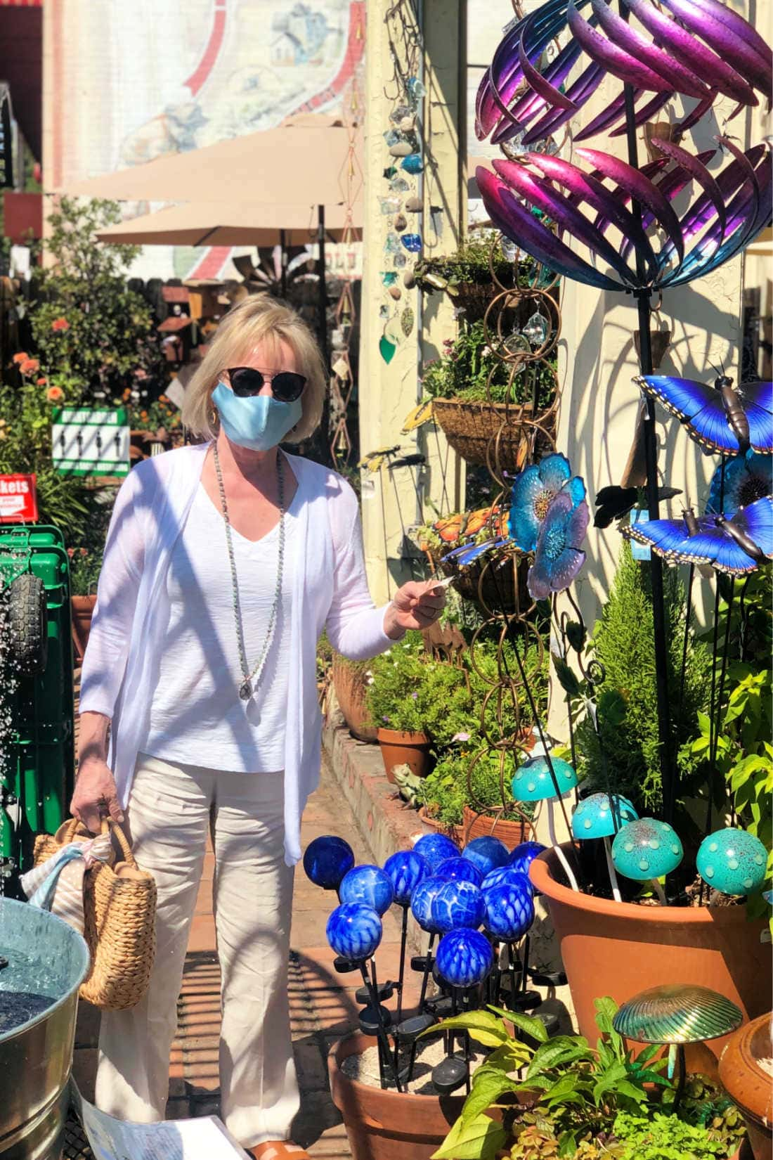 fashion blogger Jennifer Connolly surrounded by Everygreen Wind Spinners