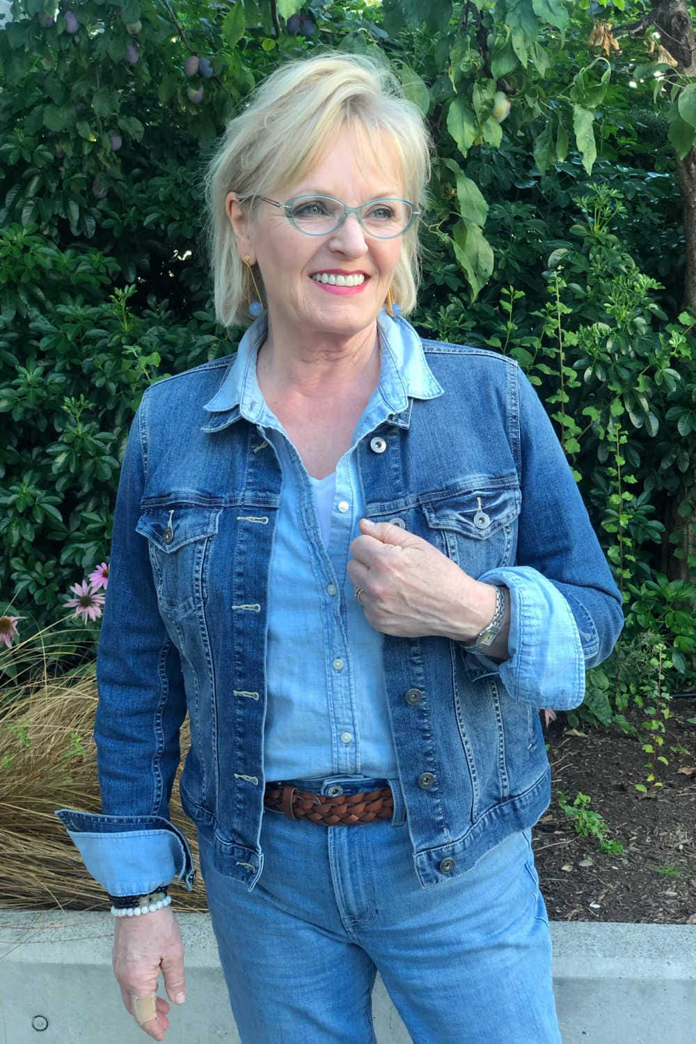 fashion blogger Jennifer Connolly wearing blue denim jacket and chambray shirt