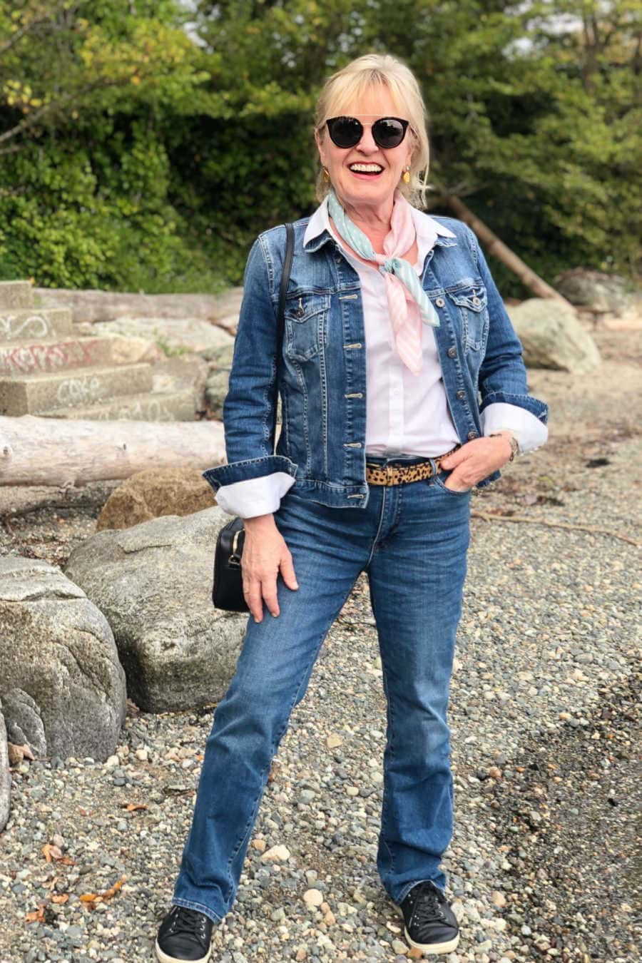 jennifer of a well styled life wearing double denim on the beach