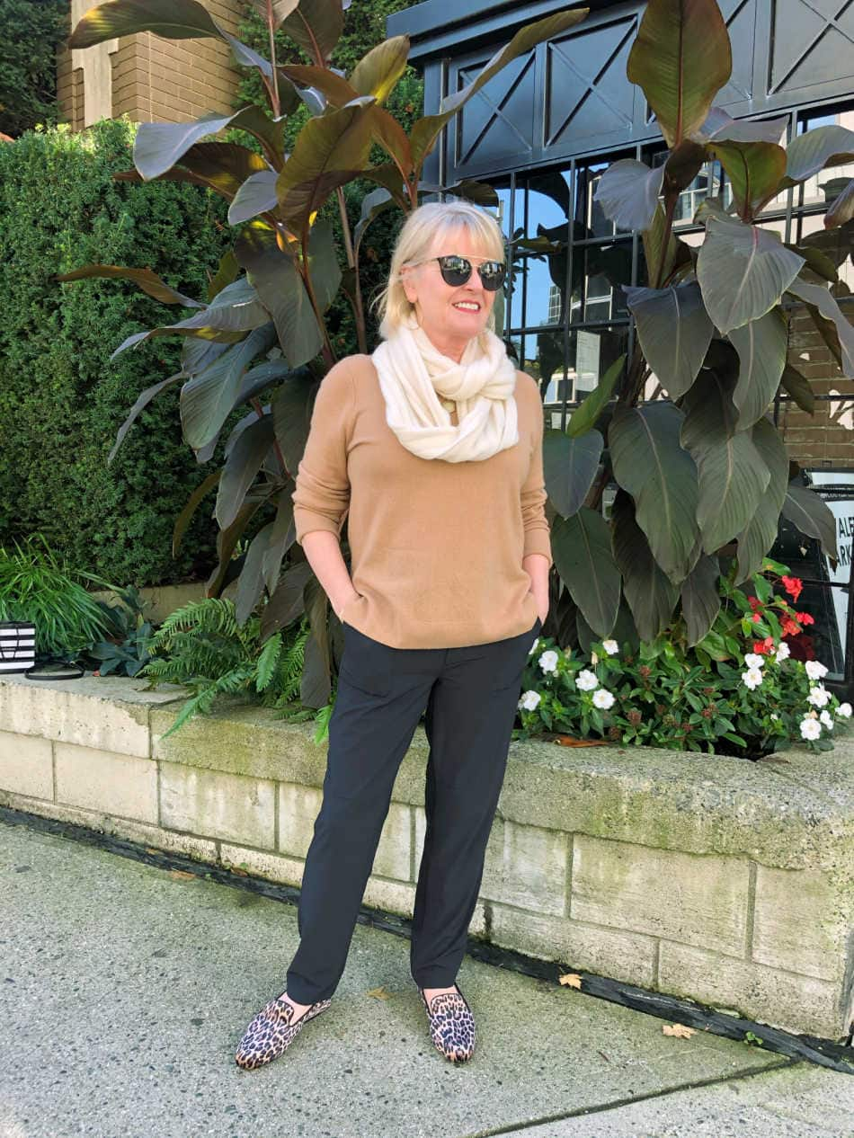 camel sweater, black pants and leopard slipper outfit
