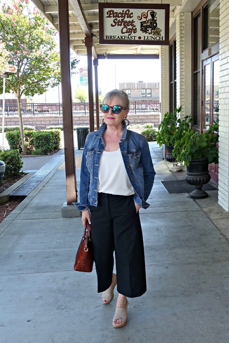 fashion blogger jennifer of A Well Styled Life wearing denim jacket and modern crop pants