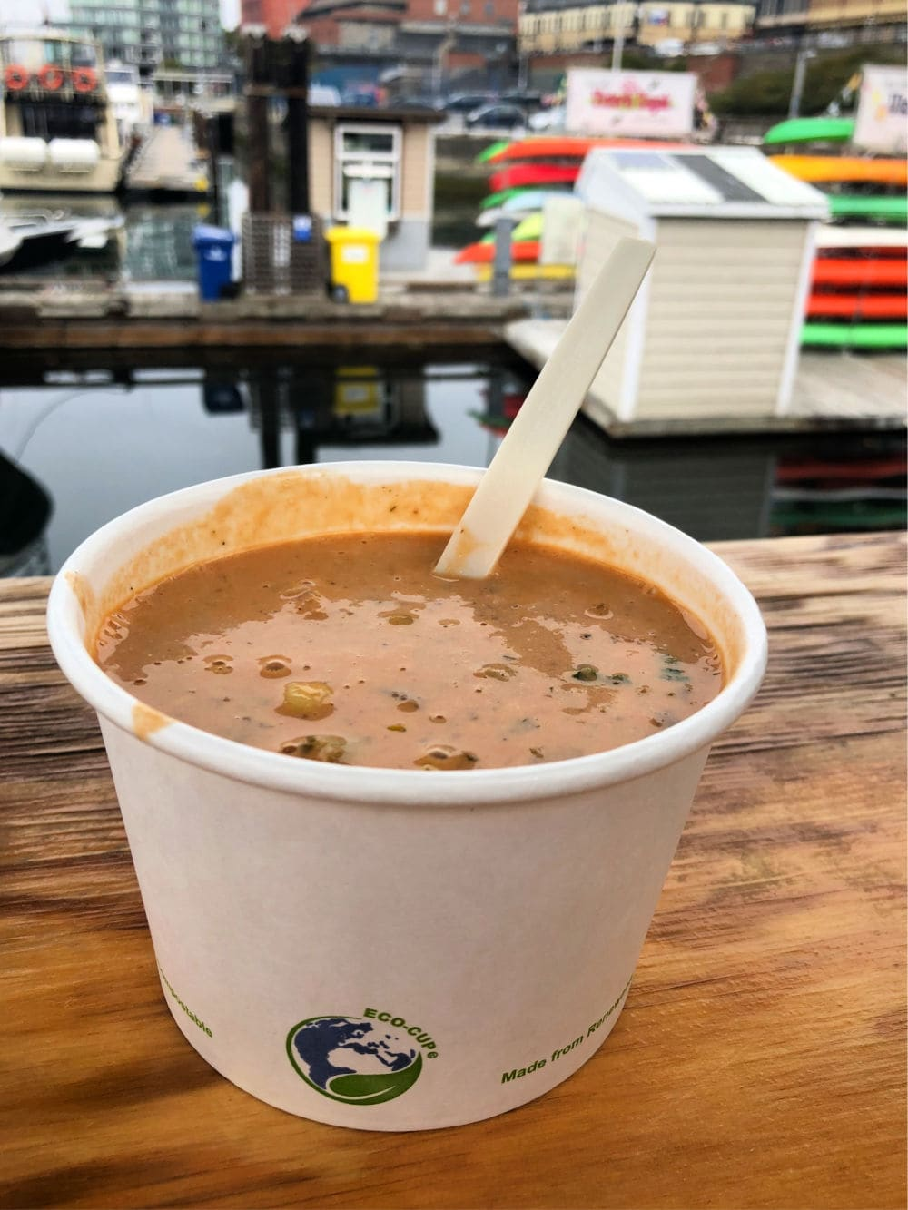 cup of red fish blue fish chowder on dock in victoria