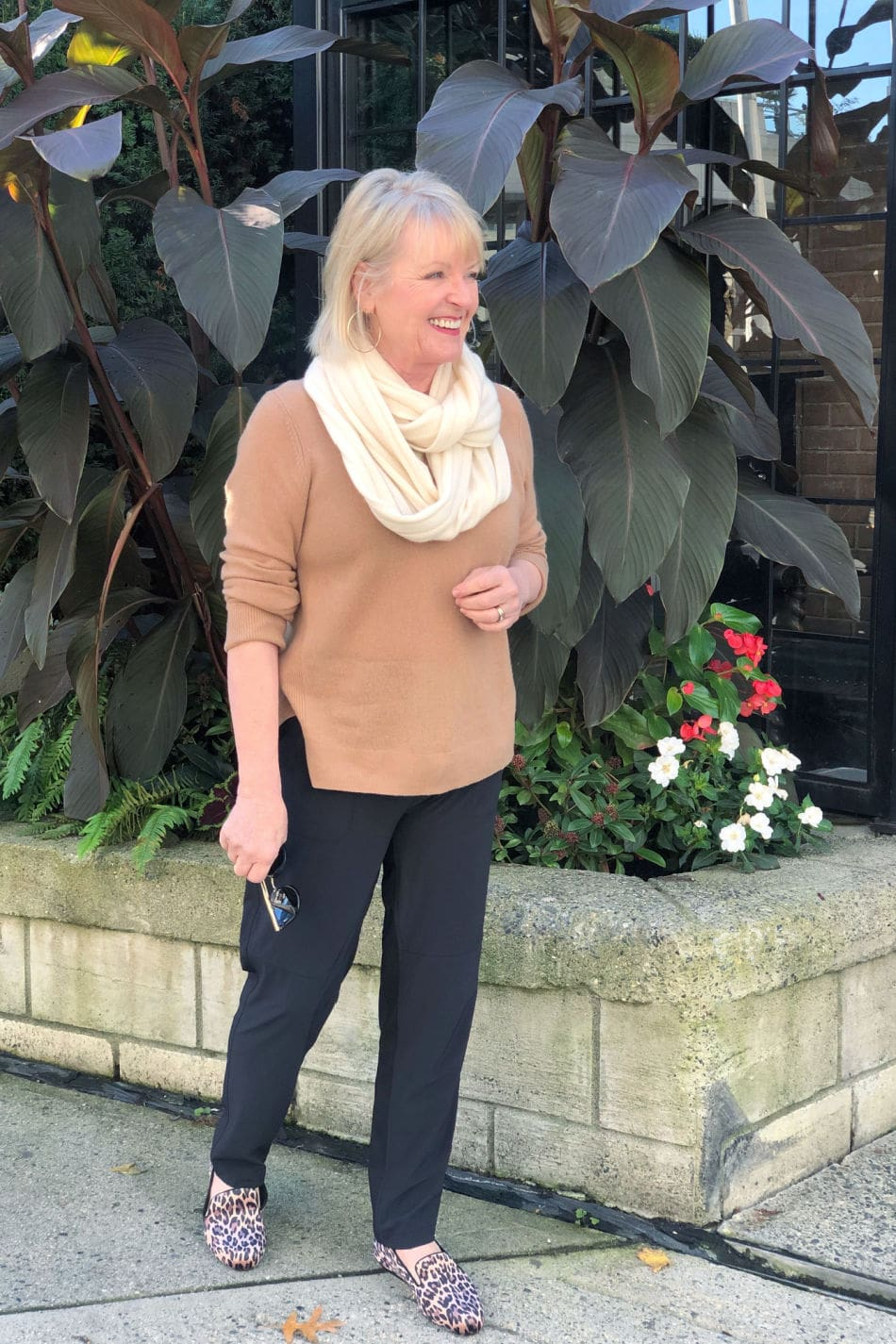 fashion blogger jennifer connolly of a well styled life wearing casual outfit of ahlogen camel sweater, black zella pants and caslon leopard shoes