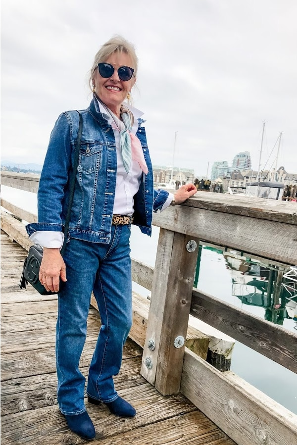 women wearing denim jacket and blue jeans on dock in victoria harbor